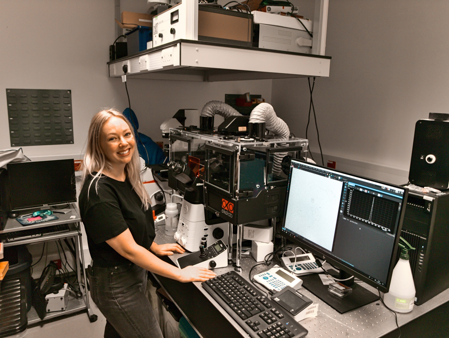 Katrina Wesencraft in a lab with a microscope